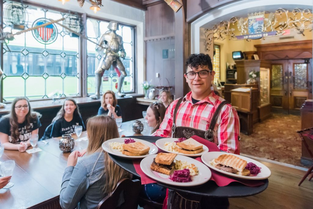 waiter carrying platter of German cuisine