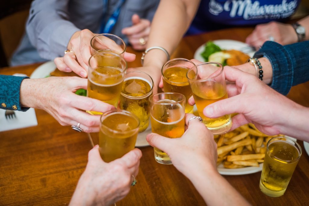doing cheers and enjoying beer