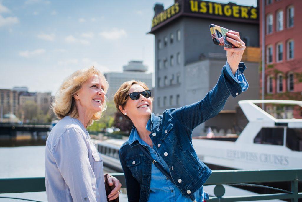 Women taking a selfie on a bridge