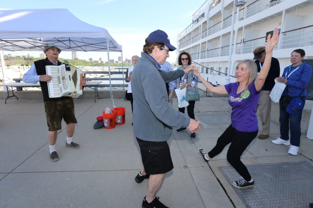 tour guide polka dancing with guest